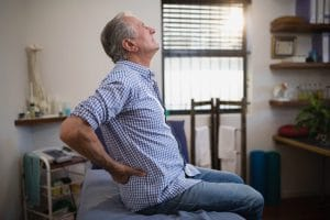 Senior suffering from hip pain