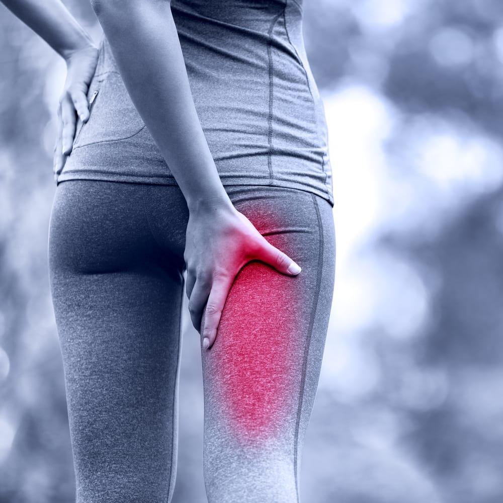 a women that's having a sciatica leg pain