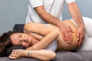 Pregnant woman getting prenatal chiropractic treatment at Houston Spine & Rehab